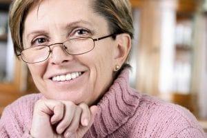 dental-implants-san-diego-pink-sweater