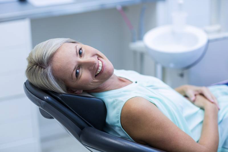 Female Model Laying Down on Dental Chair