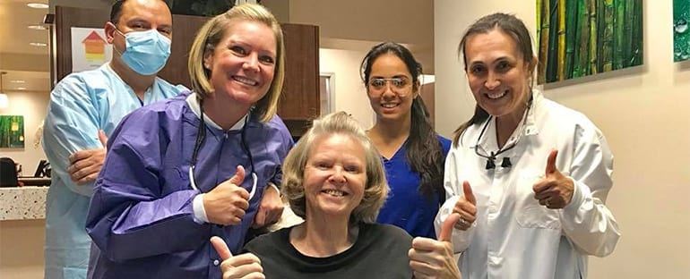 Dr. Beck Giving Thumbs Up with Patient and Team Copy 1