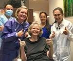 Dr. Beck Giving Thumbs Up with Patient and Team