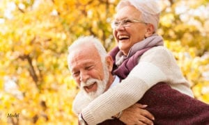 Older Man Carrying Older Woman in His Back