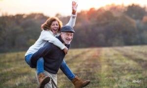 Mature Couple Having Fun in A Field